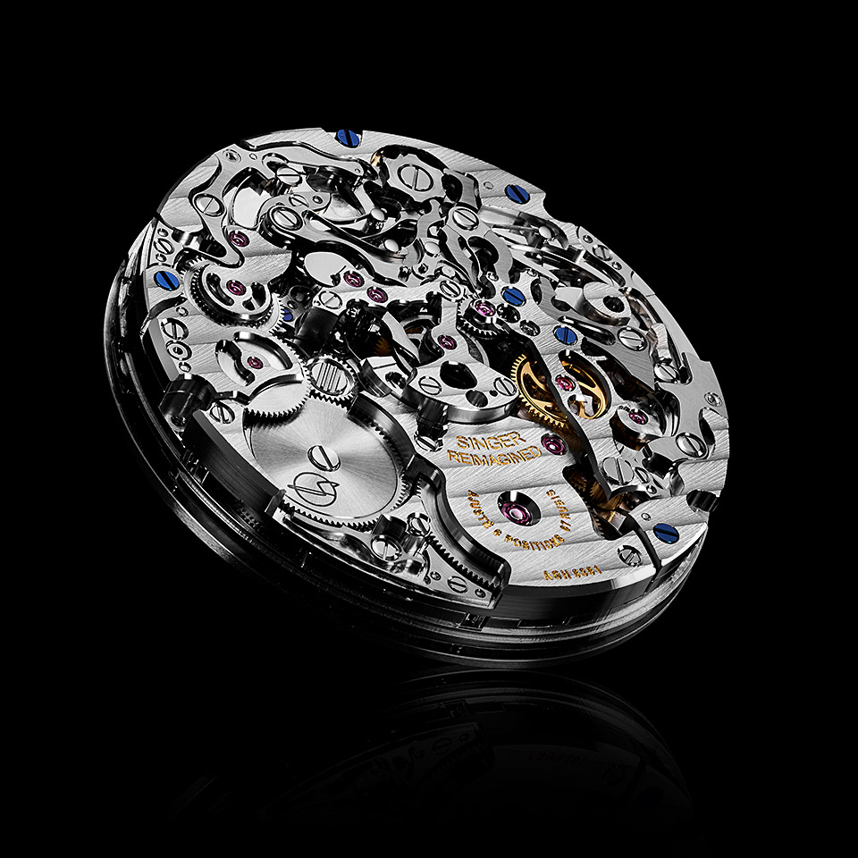 central chronograph caliber on black backgrounders
